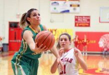 Rhea County's Jesse Wallis works inside for an under-handed layup. (photo:JohnCannon/RheaReview)