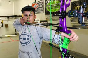 Jacob draws back new Elite Archery bow. (ElmerHarris/RheaReview)