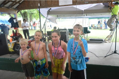 Tyler Mutchler, second from the left, shown here with younger watemelon eating competitors, lost a tooth but hardly missed a bite.